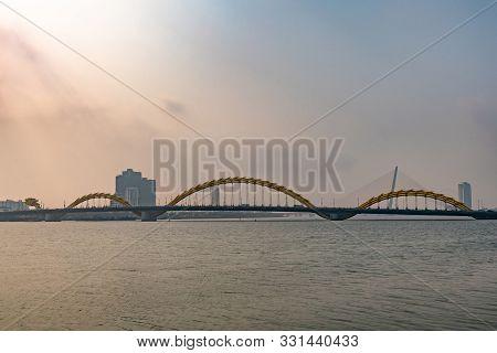 Da Nang, Vietnam - March 10, 2019: Long Shot Over Wide Han River On Cau Rong Or Dragon Bridge On Hor