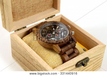 A Closeup View Of A Beautiful Handcrafted Walnut Wood Mens Wrist Watch Being Displayed Inside A Comp
