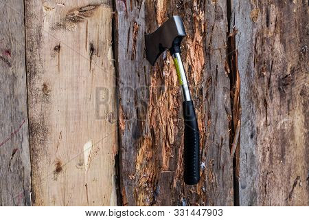 Small Axe Stuck In A Wood Board As Part Of An Axe Throwing Competition