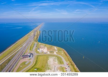 Afsluitdijk, A Major Dam And Causeway In The Netherlands, Runs From Den Oever In North Holland To Vi