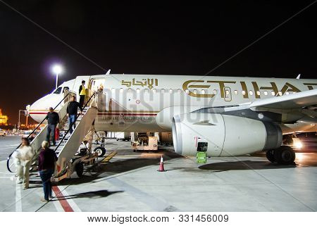 Abu Dhabi . October 2011.passengers Disembark From The Airbus A319 Aircraft Etihad Airways At The Ai
