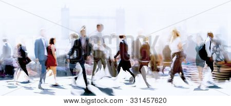 Lots Of Business People Walking In The City Of London. Blurred Image, Wide Panoramic View Of The Roa