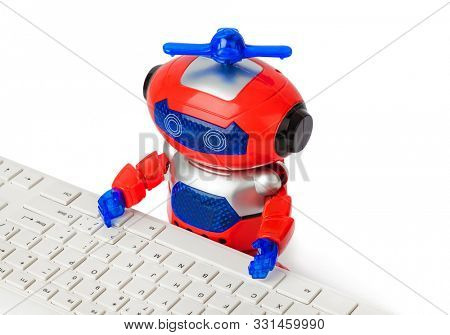 Toy robot and computer isolated on white background