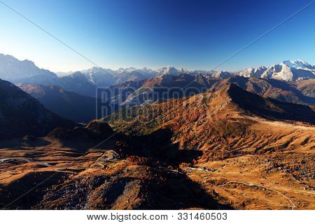 Autumn colours over Marmolada Peak - 3343meters, the highest mountain in the Dolomites, Italy