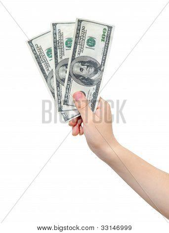 Hand holding dollars
