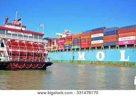 Savannah, Georgia - November 3, 2019 The Container Ship, Mol Partner, Passes By The Docked Paddleboa