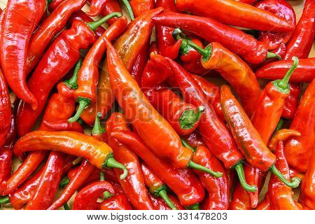 Red Hot Chilli Peppers Pattern Texture Background. Close Up. Landscape. A Backdrop Ofred Hot Chilli