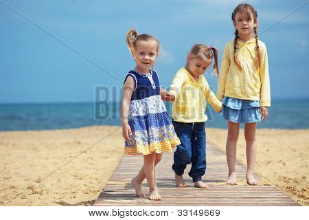 Group of kids playing at the beach