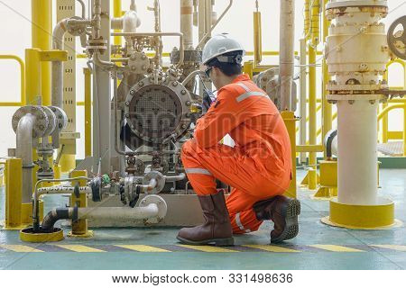Mechanical Specialist Check Oil Pump Centrifugal Type And Use Walkie Talkie Talk To Central Control