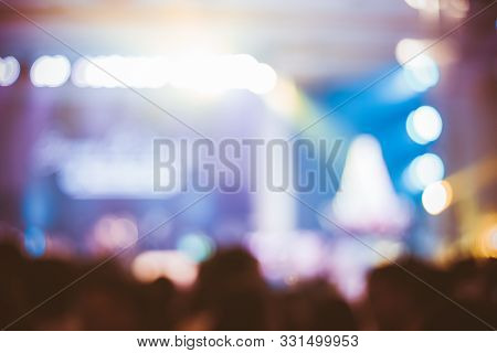 Abstract Blur Of Concert ,bright Stage Lights,many Crowds Stood In Front Of The Concert Stage.people