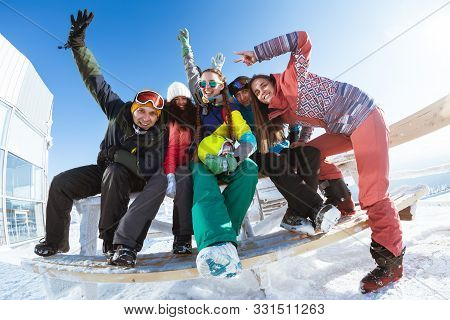 Five Happy Friends Skiers And Snowboarders Are Having Fun And Posing Together At Ski Resort