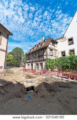 Construction Site In The Petite France Neighborhood Of Strasbourg With Road Works And Medieval House