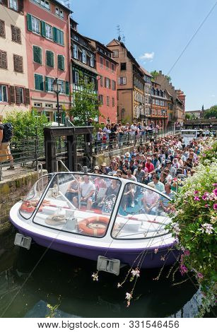 Sightseeing Cruise In Strasbourg With Passenger Boat Passing Through The River Locks On The Canals I