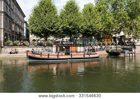 Strasbourg Canals With Boats Ready For Sightseeing Cruises Through The Old Town