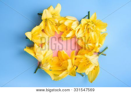 Close Up Of Lily Flowers And Card On Blue Background.
