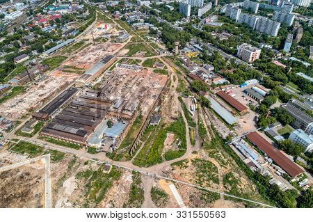 Demolition Work Of A Large Old Factory. Dismantling On The Territory Of A Big City. Shooting From A