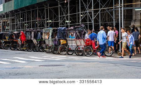 New York, Usa - June 6, 2019:  Pedal Taxis Waiting For Fares By Central Park New York City.