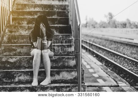 Depressed Young Asian Woman Sitting On Overpass Near Railway At Train Station,nagative Attitude,suic