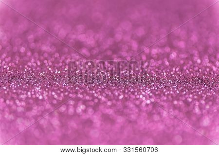 Abstract Pink Texture Glitter Lights Background. De-focused.