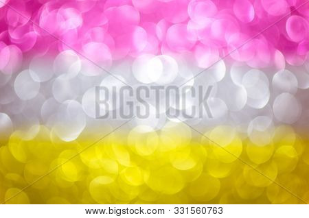 Abstract Three Color Texture Glitter Lights Background. Pink, Silver, Yellow. De-focused.