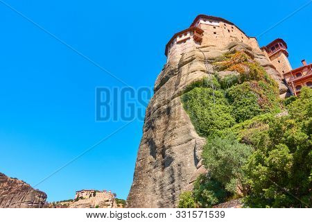 The Monasteries of Rousanou and Varlaam on the tops of the cliffs iin Meteora, Greece