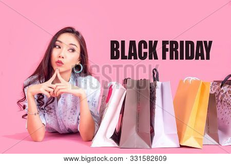 Black Friday. Lifestyle Asian Woman With Many Shopping Bags For Sale. Colorfull Background.  Lifesty