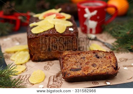 Christmas Fruitcake With Candied Fruits And Dried Fruit On Dark Background