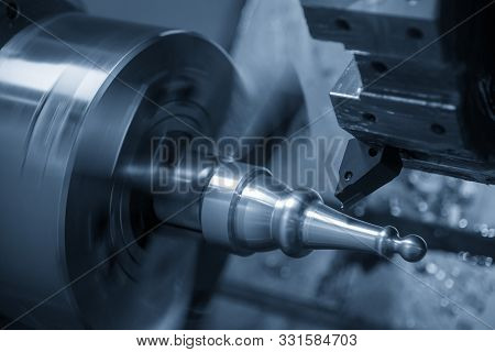 The Cnc Lathe Machine In Metal Working Process Cutting The Metal Shaft Parts With The Cutting Tools.