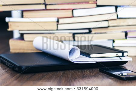 Open Textbook, Notebook, Smartphone, Laptop Computer, Stack Of Books Education Back To School Backgr