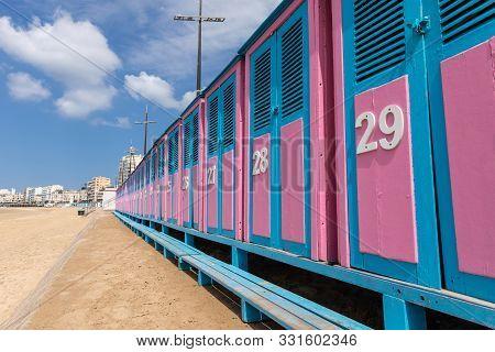 Blue And Pink Cabins Of Les Sables Beach (les Sables D Olonne, France)