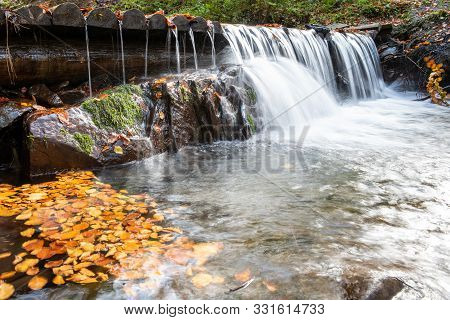 Colorful Majestic Waterfall In Autumn Forest