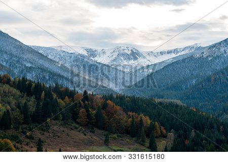 Amazing Mountain Landscape With Colorful Vivid Sunset With Snow In Top