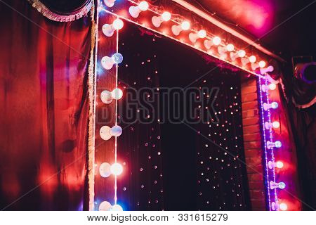Light Bulbs On Stage Theatrical Scene With Colored Glitter Neon Bulbs For Presentation Or Concert Pe