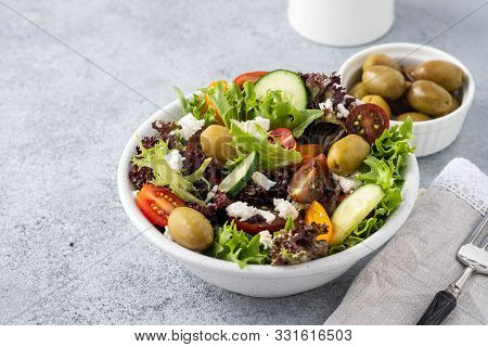 Salad Of Fresh Vegetables And Herbs With Olives And Feta Cheese.