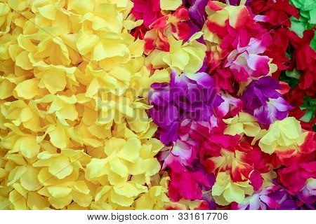 Artificial Flowers Background. Close-up Of Nice Rainbow-colored Petals Made Of Fabric On A Beautiful