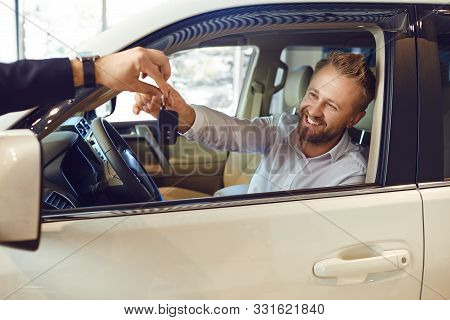 Auto Dealer Shows A New Car To A Man