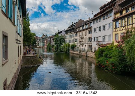 The Old Canals And Half-timbered Houses In Strasbourg