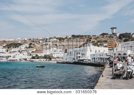 Mykonos Town, Greece - September 23, 2019: People Walking By The Water On A Sunny Day In Hora, Also