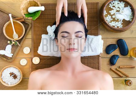 Top View Young Woman Is Getting Head Massage, Therapy. Master Hands Are Massaging Kneading Temples O