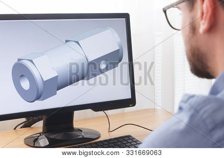 Engineer, Constructor, Designer In Glasses Working On A Personal Computer. He Is Creating, Designing