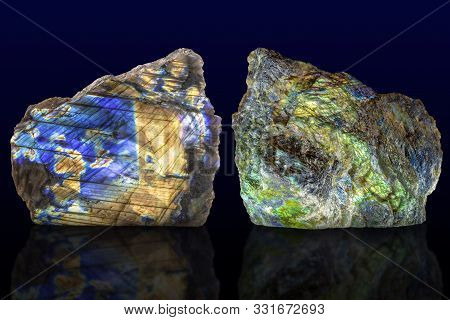 Polished Side And Raw Side Labradorite (labrador) Gemstone On Dark Background