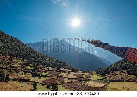 Hiker Backpacker Man Using Trekking Poles Showing On Thamserku 6608m Mountain During High Altitude A