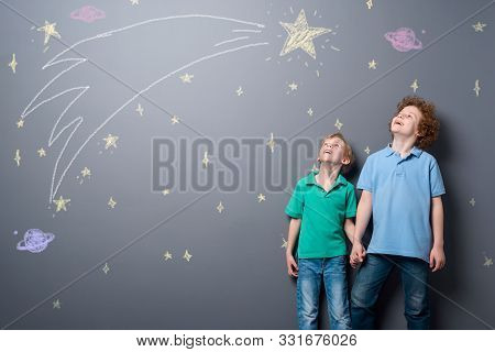 Two Brothers Gazing At Stars. Little Children Admire A Big Comet Flying Through The Sky Full Of Star