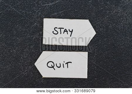 Changing Job Conceptual Still-life, Stay Vs Quit Text On Signs Pointing At Opposite Directions