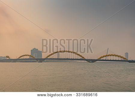 Da Nang, Vietnam - March 10, 2019: Shot Over Wide Han River On Cau Rong Or Dragon Bridge On Horizon