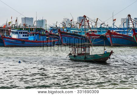 Da Nang, Vietnam - March 10, 2019: Blue-red Colored Fishing Vessels Anchored Together On Southeast L