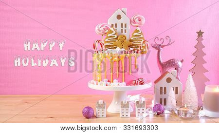 Candyland Childrens Party Christmas Cake In Pink And Gold Table Setting.
