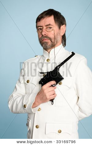 Man in the form of a naval officer with a gun.