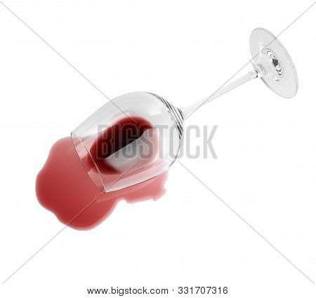 Transparent Glass And Spilled Exquisite Red Wine On White Background, Top View