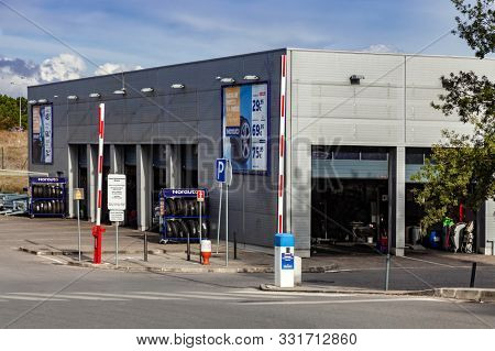 Coina, Portugal - October 23, 2019: Norauto car or auto service station and parts shop. Auto repair shop in Barreiro Planet Retail Park. Norauto is a French company